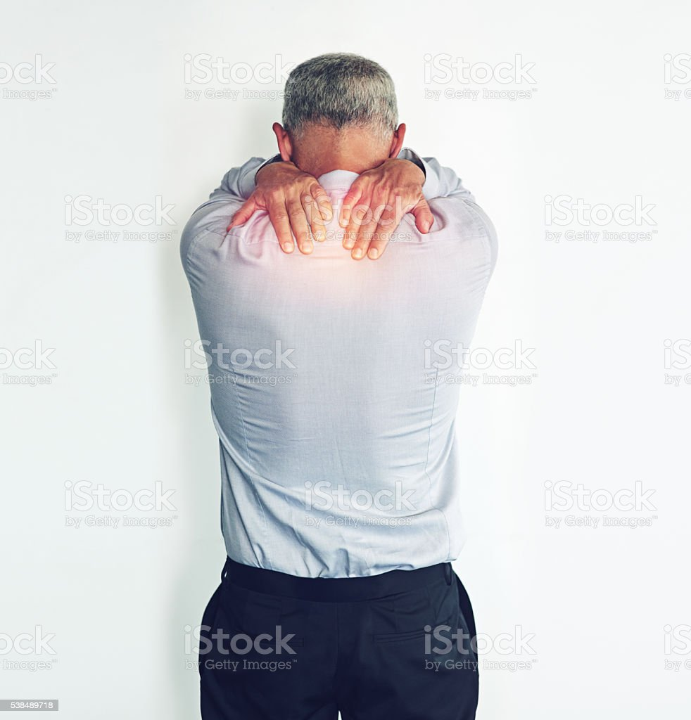 He needs a quick pain reliever stock photo