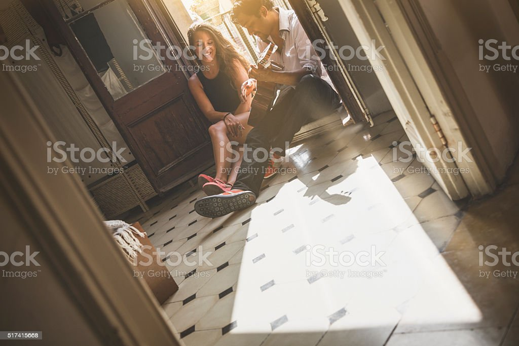 He plays guitar for her stock photo