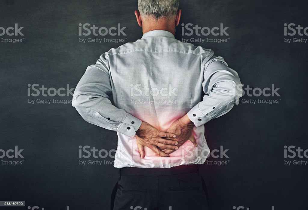 He puts his back into his job stock photo