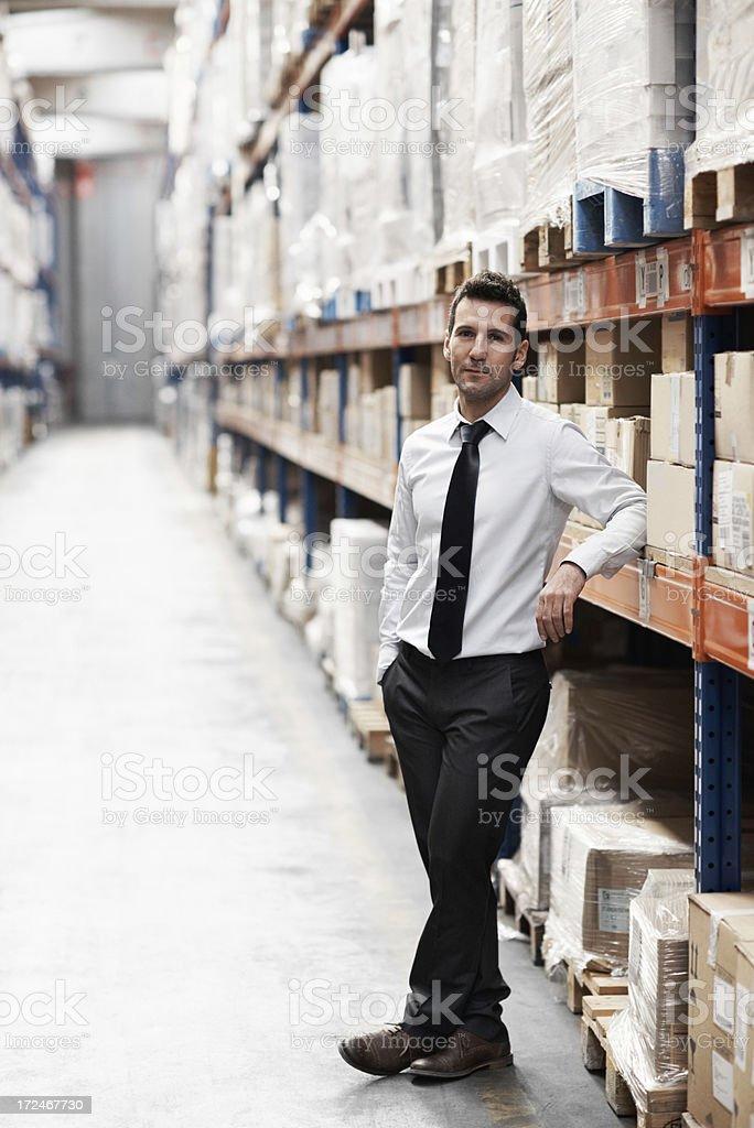 He runs an organised warehouse royalty-free stock photo
