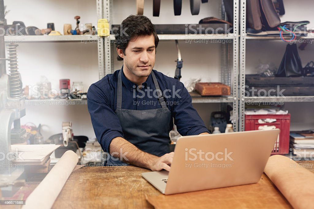 He sells his leather products online stock photo