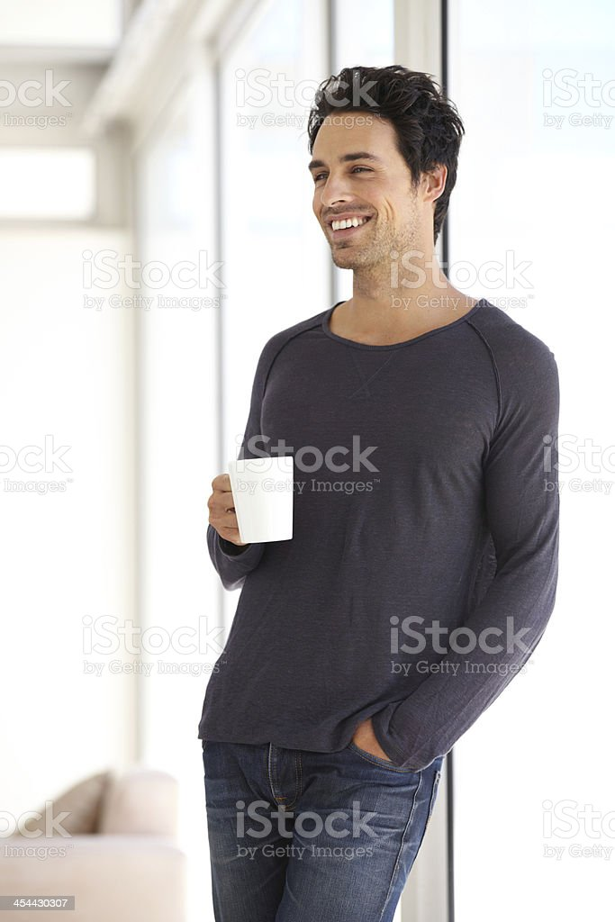 He starts everyday with a cup of coffee royalty-free stock photo