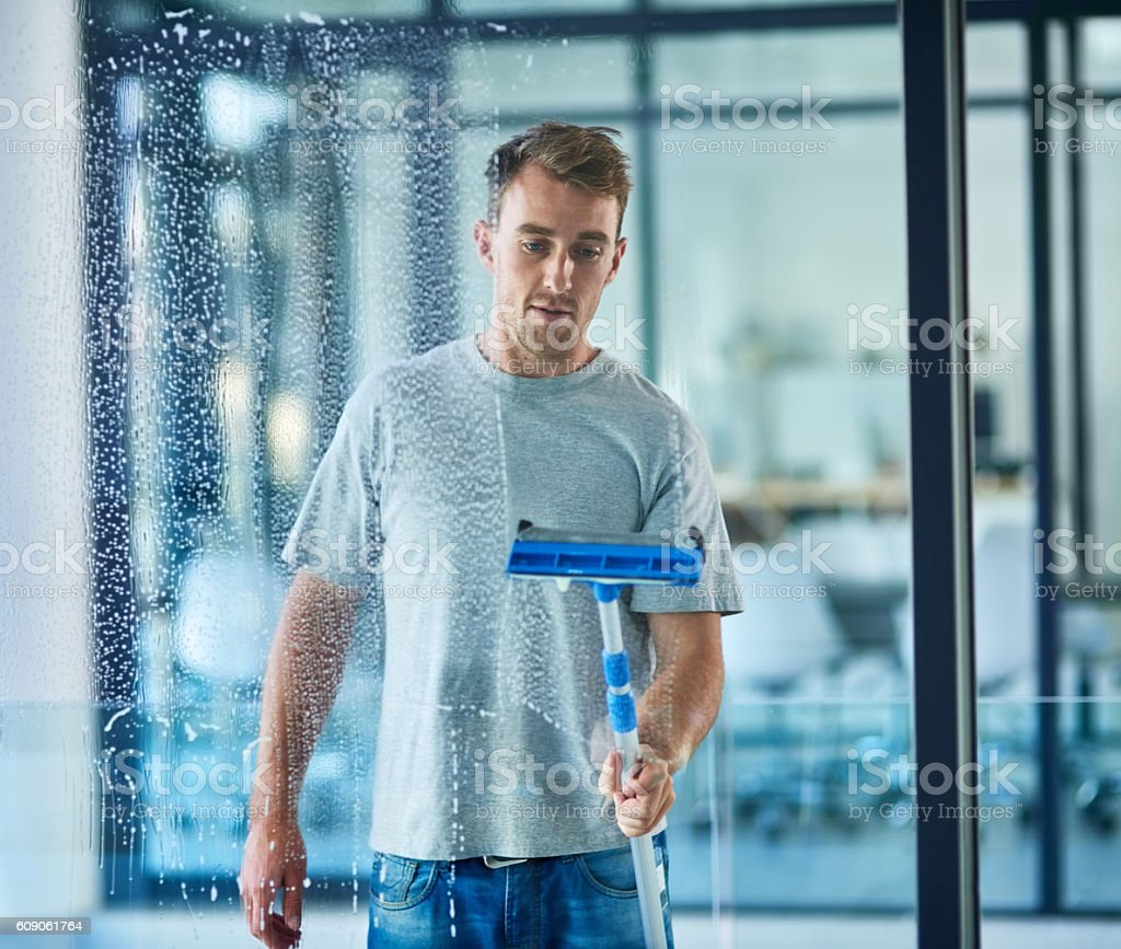 He takes pride in his cleaning stock photo
