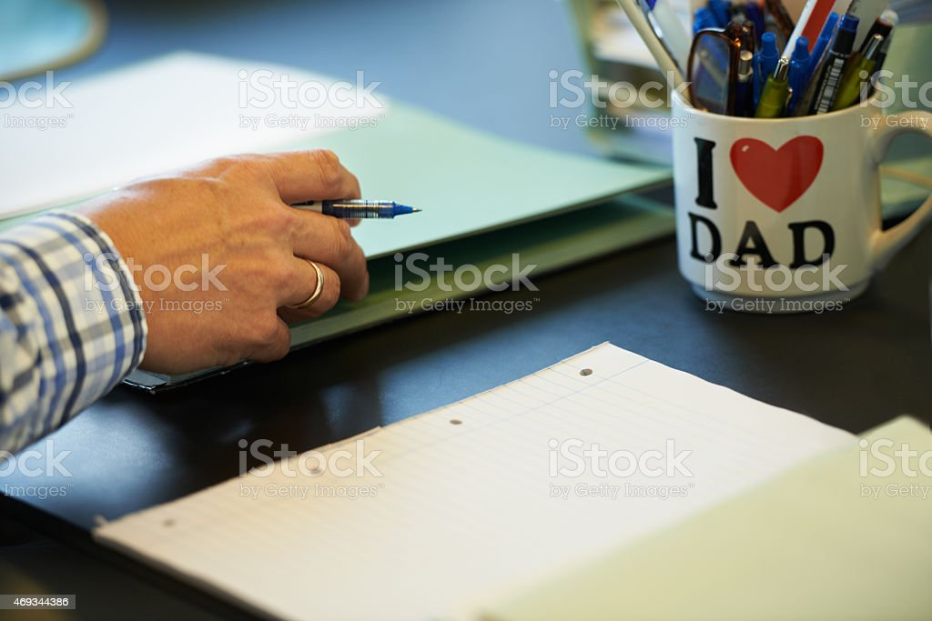 He takes pride in his workspace stock photo