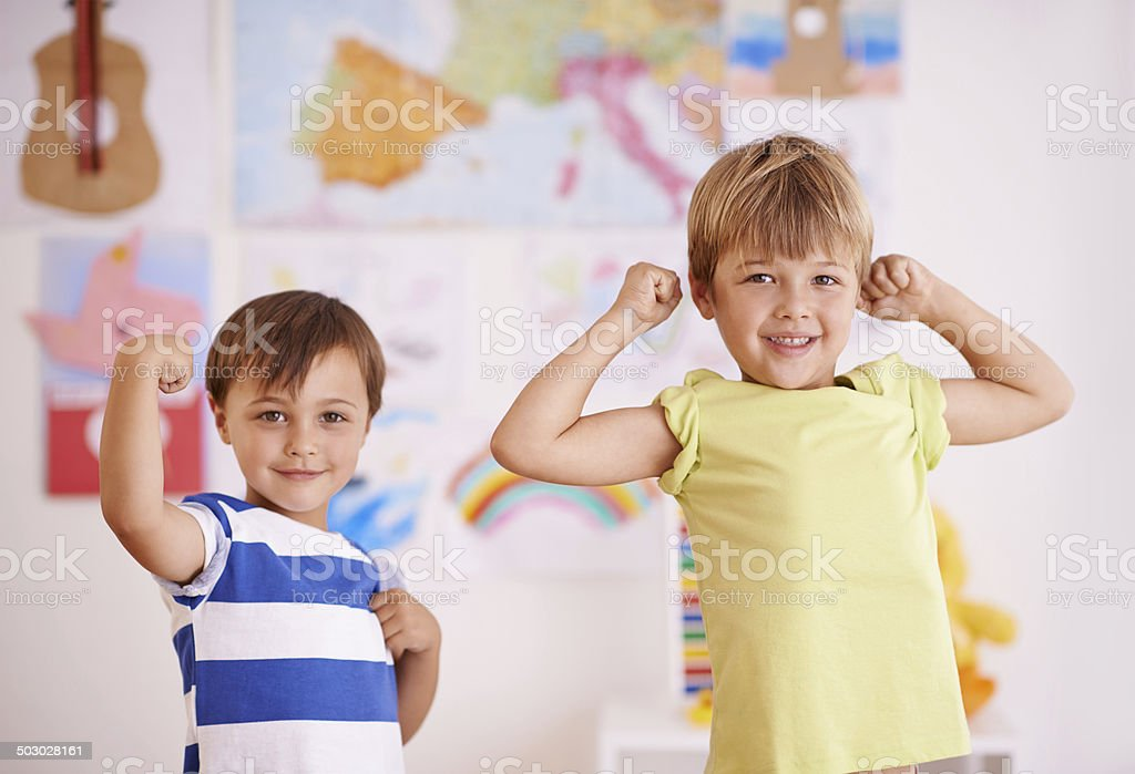 He wants to be just like his big bro! stock photo