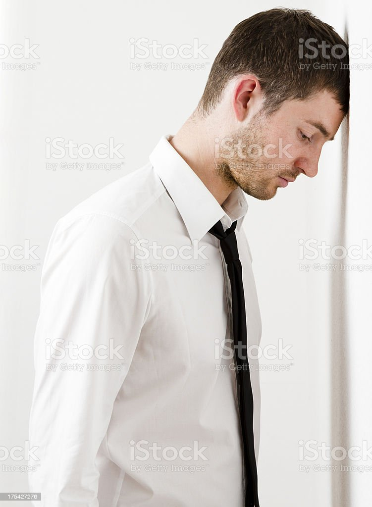 Head against wall. stock photo
