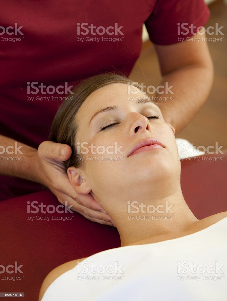 head and neck massage of a beautiful woman stock photo