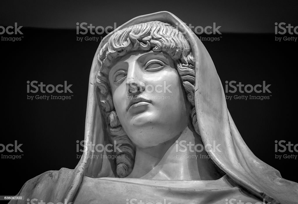 Head and shoulders detail of the ancient sculpture stock photo
