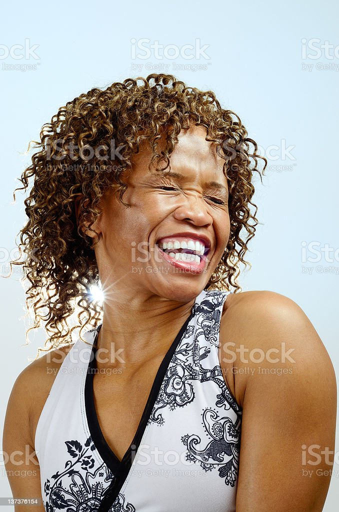 Head and shoulders of a laughing woman stock photo