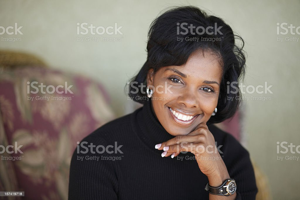 Head and shoulders of a woman with out of focus background royalty-free stock photo