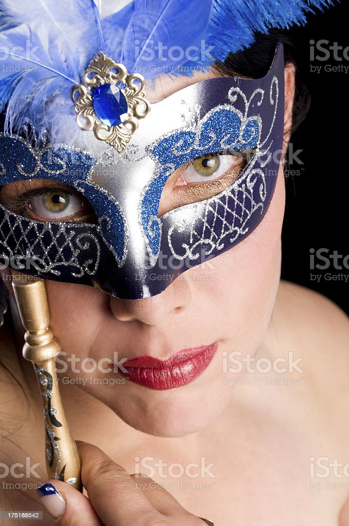 Head and shoulders of woman with blue mask. stock photo
