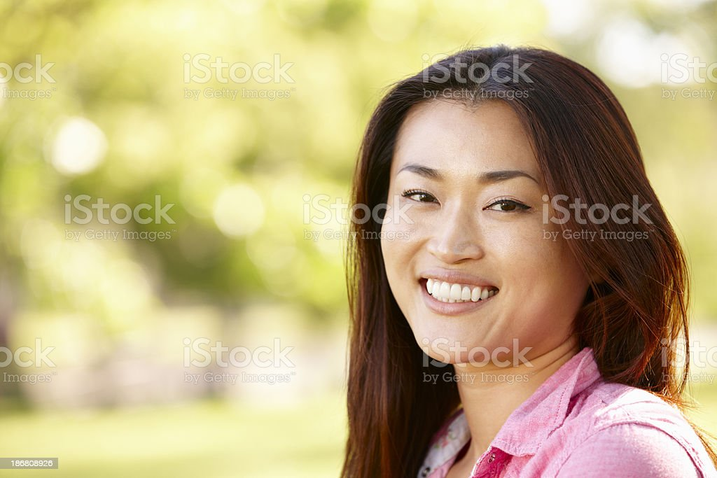 Head and shoulders portrait Asian woman outdoors royalty-free stock photo