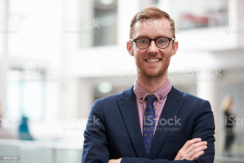 Head And Shoulders Portrait Of Businessman In Office stock photo