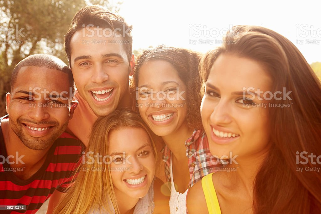 Head And Shoulders Portrait Of Friends On Holiday stock photo