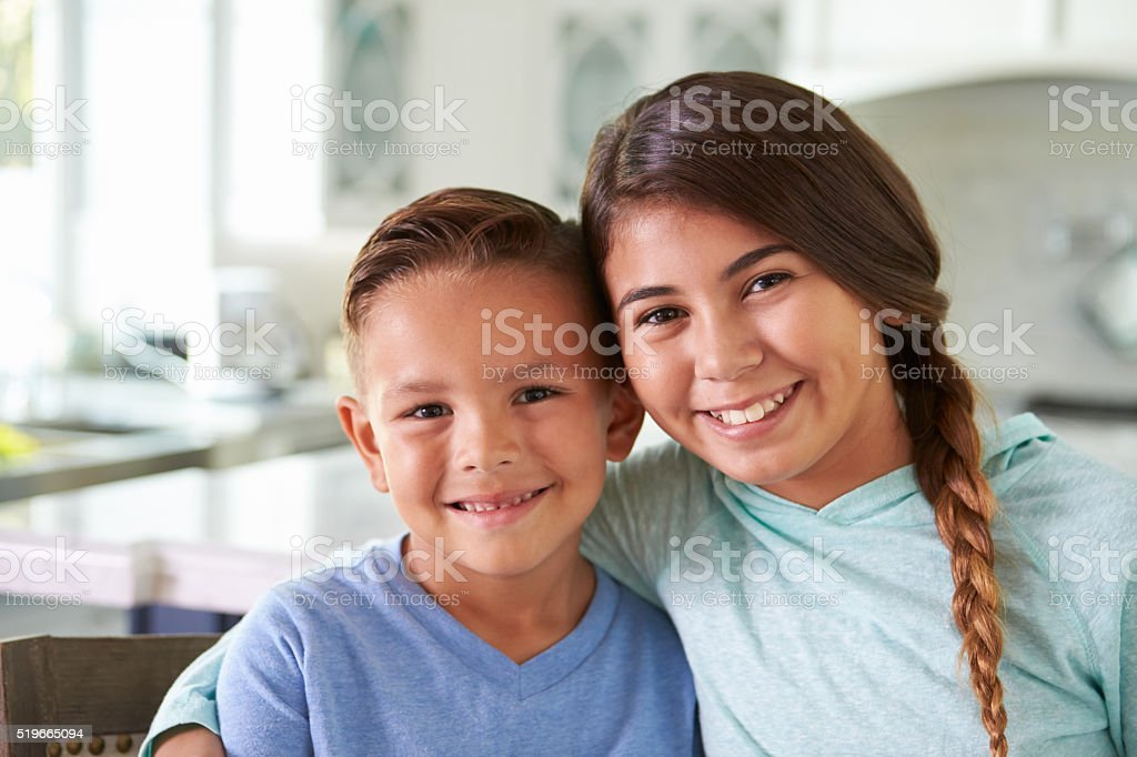 Head And Shoulders Portrait Of Hispanic Children At Home stock photo