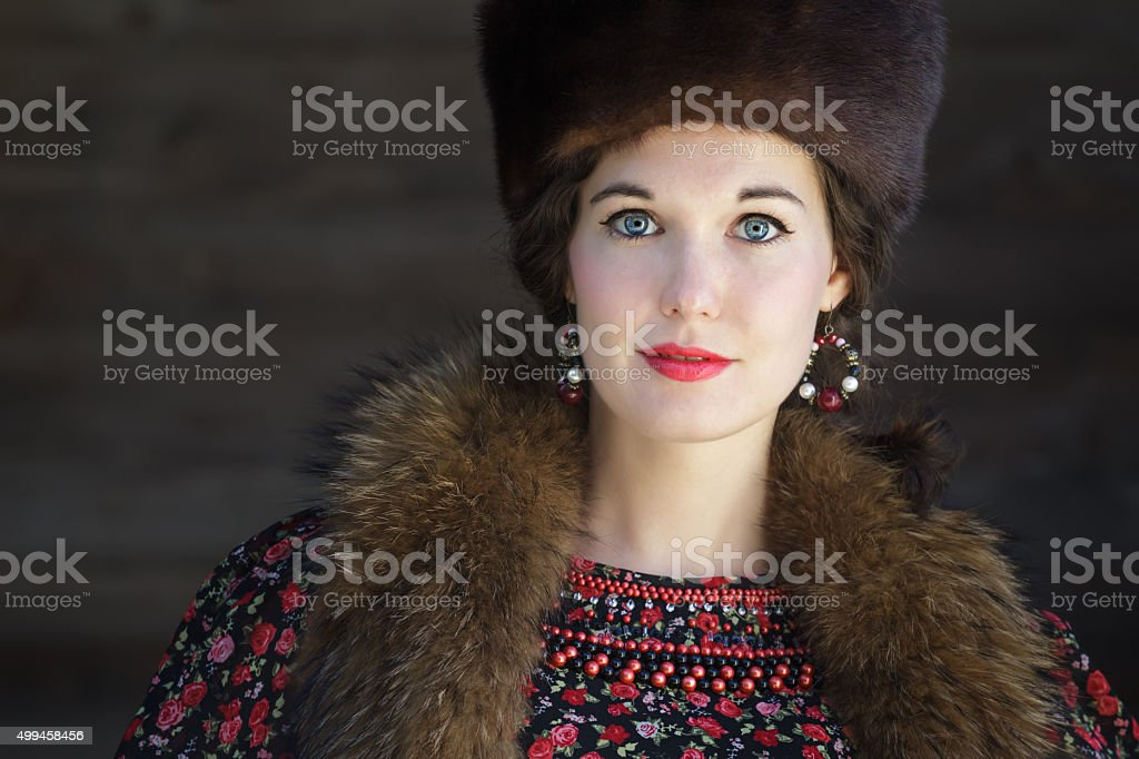 Head and shoulders portrait of Russian beauty with blue eyes stock photo