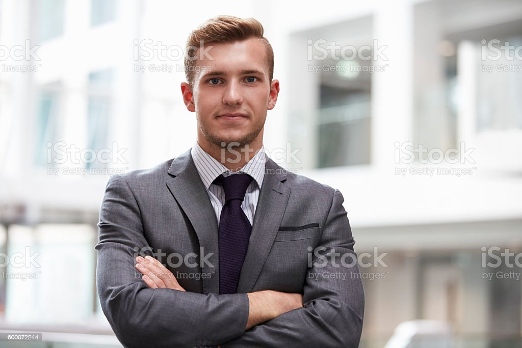 Head And Shoulders Portrait Of Young Businessman In Office stock photo