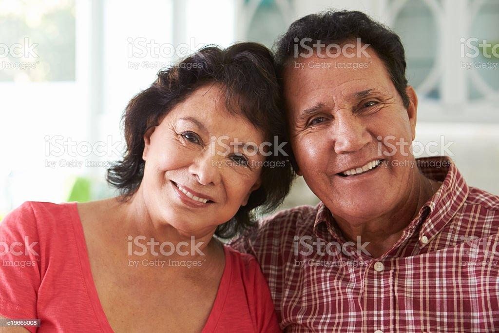 Head And Shoulders Shot Of Senior Hispanic Couple At Home stock photo