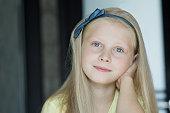 Head and shoulders studio shot portrait of teenage girl