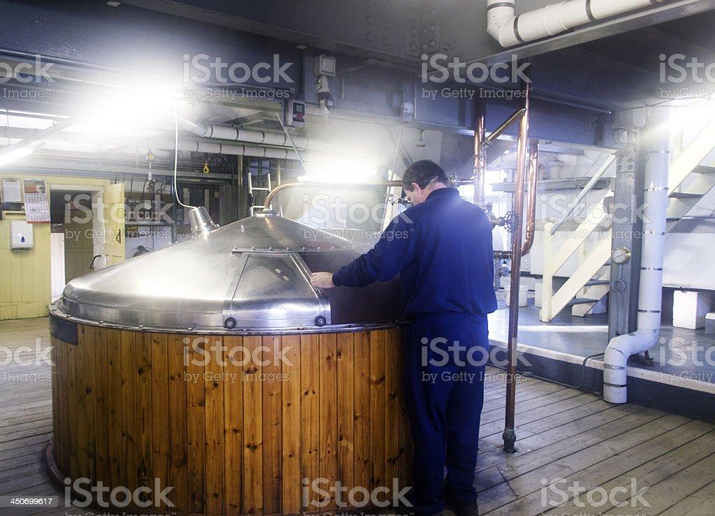 Head brewer inpecting the Mash tun stock photo