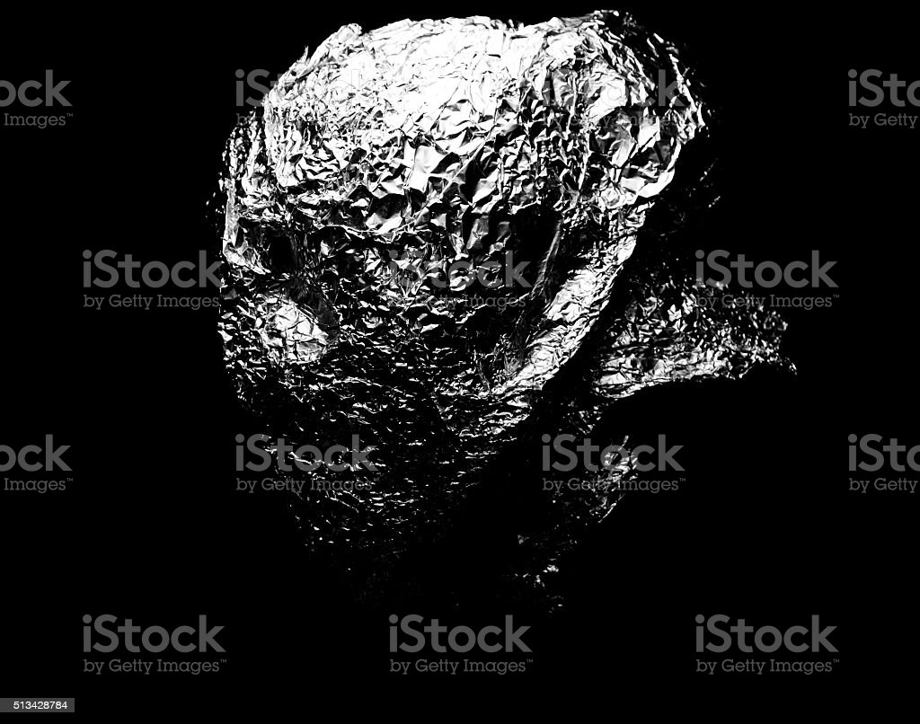 head covered by silver foil stock photo