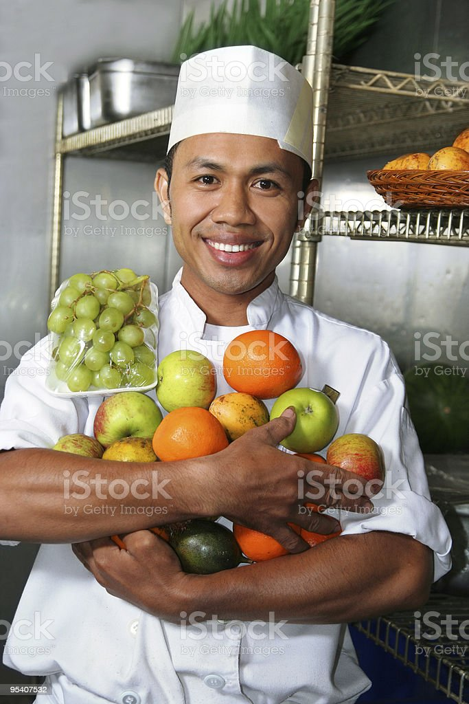 chef holding fruits stock photo