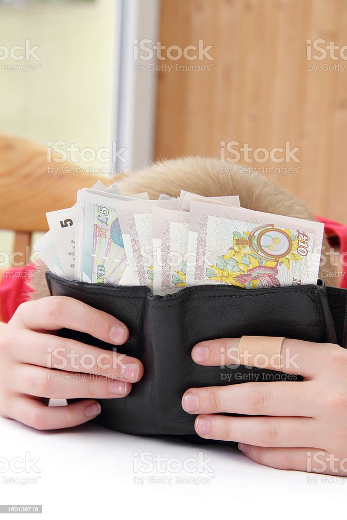 head hiding behing money stock photo