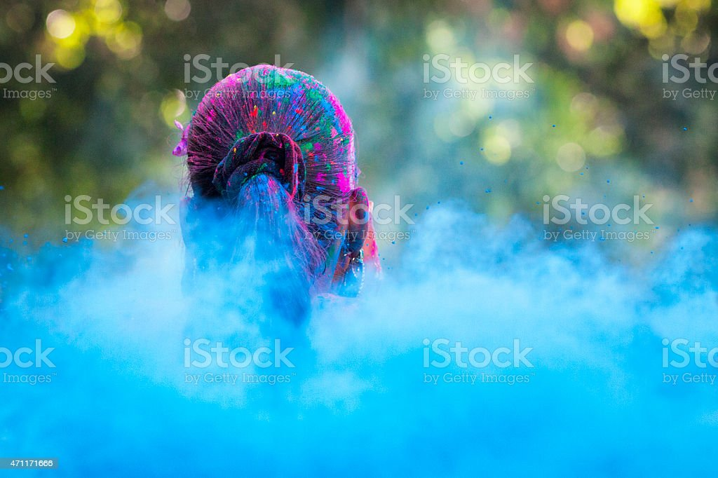 Head in Sea of Dye at Holi Festival stock photo