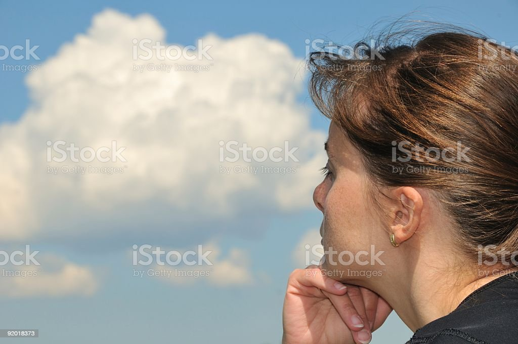 Head in sky - dreaming young woman stock photo