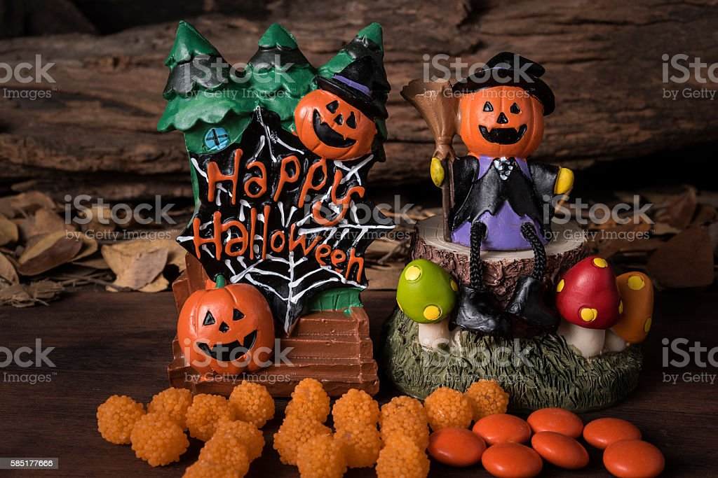 Head jack in witch suit sitting on a tree stock photo