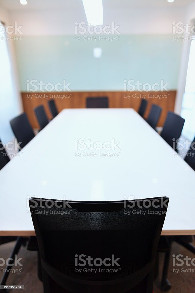 Head leader's chair of business conference table in office stock photo