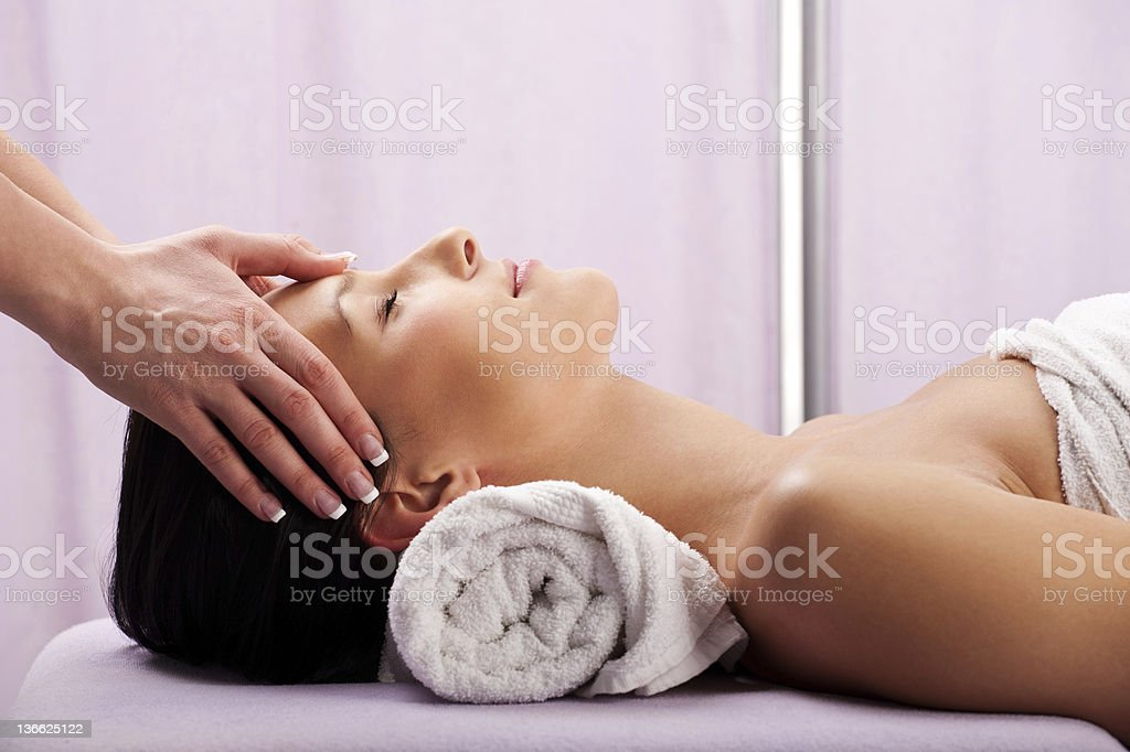 Head massage in spa center royalty-free stock photo