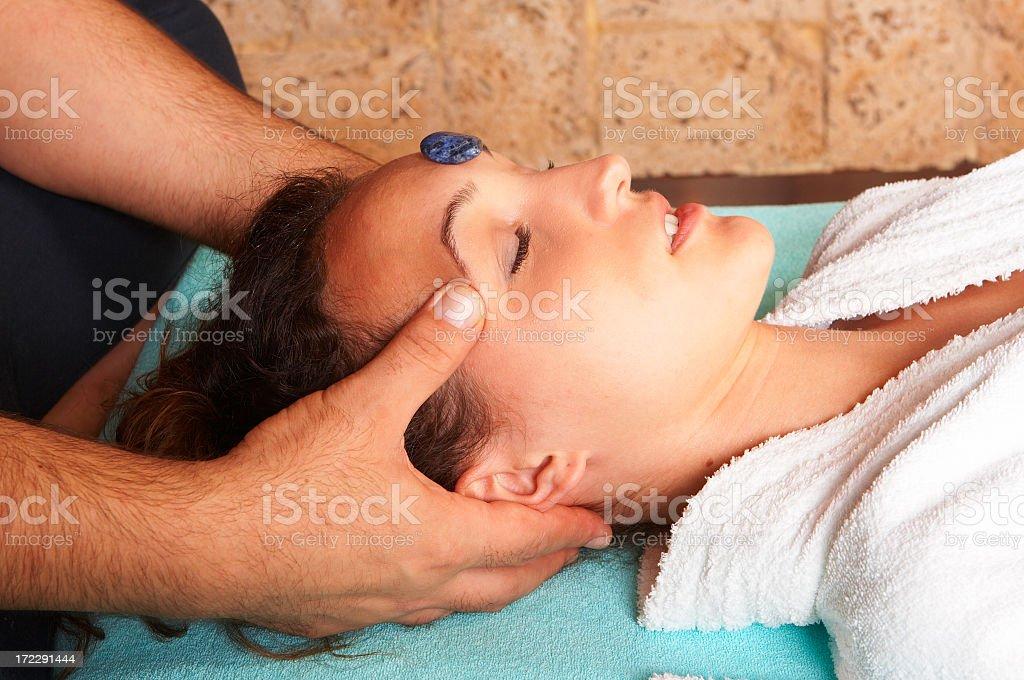 Head massage with hot stone royalty-free stock photo