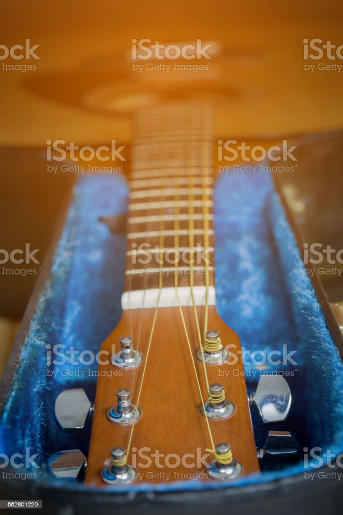 head of acoustic guitar with hard case stock photo