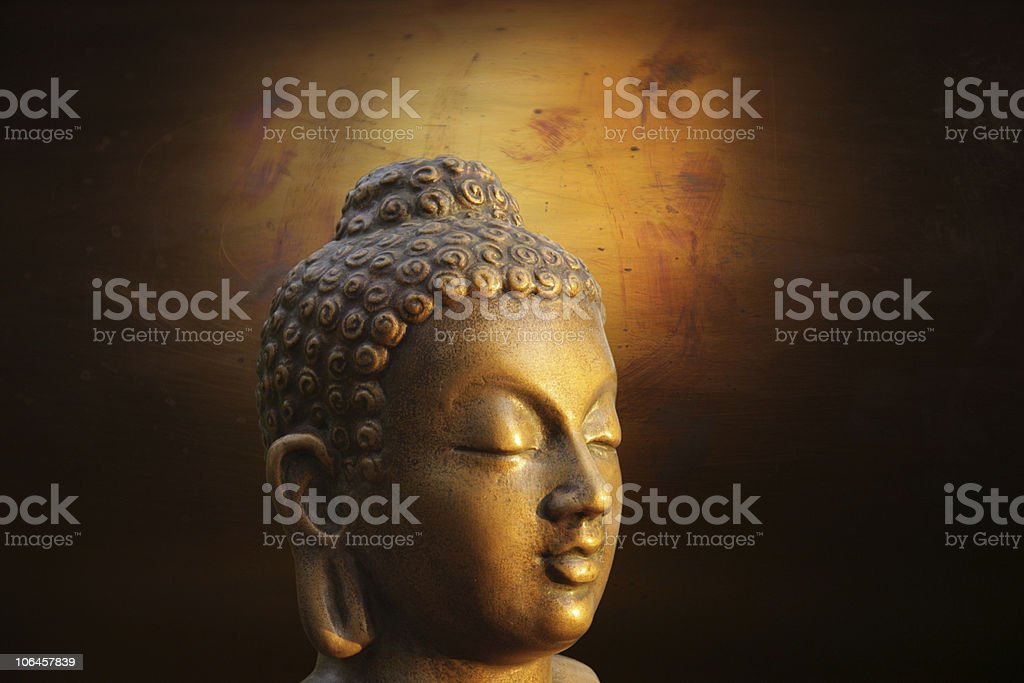 Head of Budha on golden background royalty-free stock photo