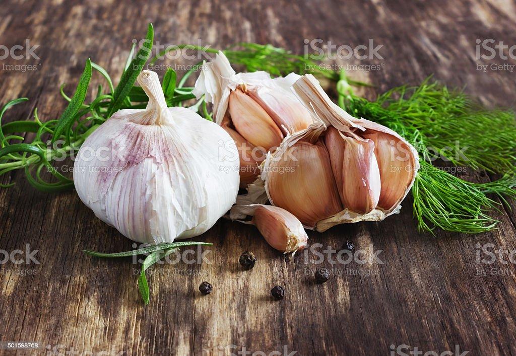 head of garlic and herbs stock photo