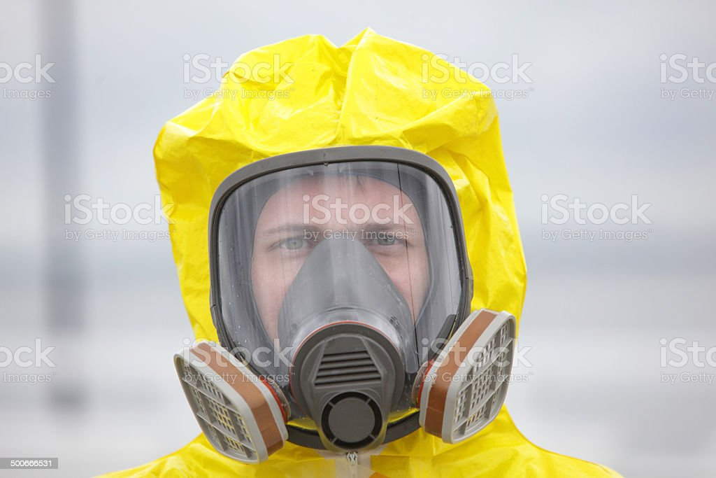 Head of man in modern gas mask - close up stock photo