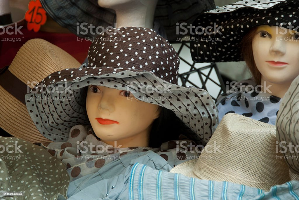 Head of mannequin with hat on a French market stock photo