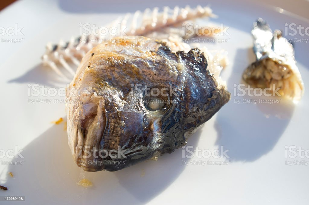 head of trout cooked stock photo