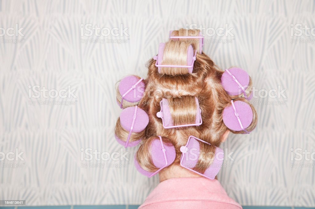 Head of woman with curlers in hair stock photo