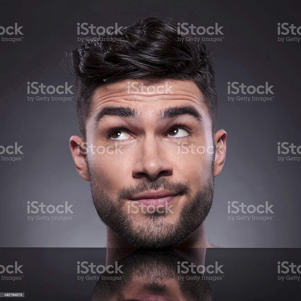 head of young man looking to his side stock photo