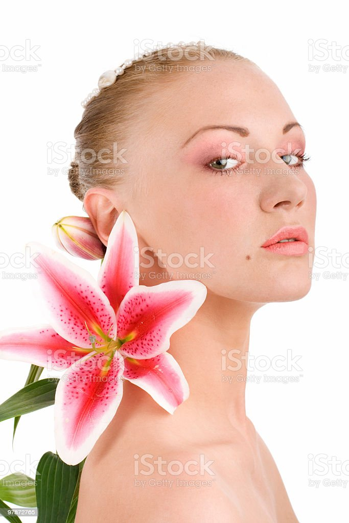 Head of young woman with lily on isolated background royalty-free stock photo