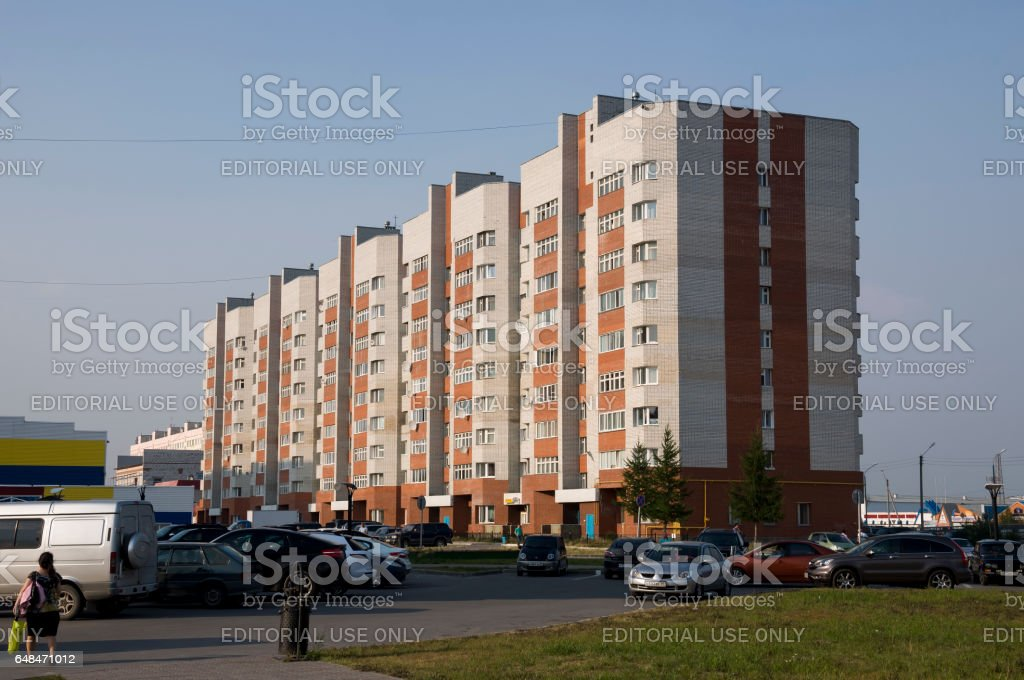 Head office of Gazprom mining Yamburg. Modern multi-storeyed building from white and orange brick Editorial 1 stock photo