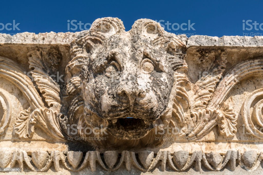 Head relief in Letoon ancient city, Mugla stock photo