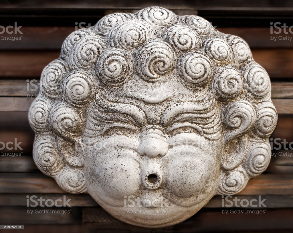 Head sculpture with chubby cheeks royalty-free stock photo