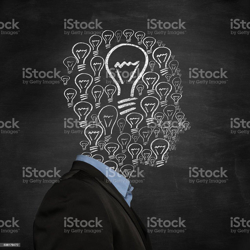 head shape made of light bulbs hand drawn on blackboard stock photo