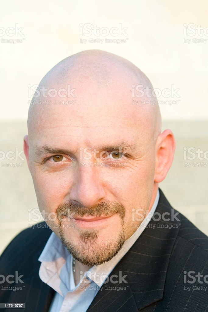 Head Shot 30's Bald Guy with Goatee Looking at Camera royalty-free stock photo