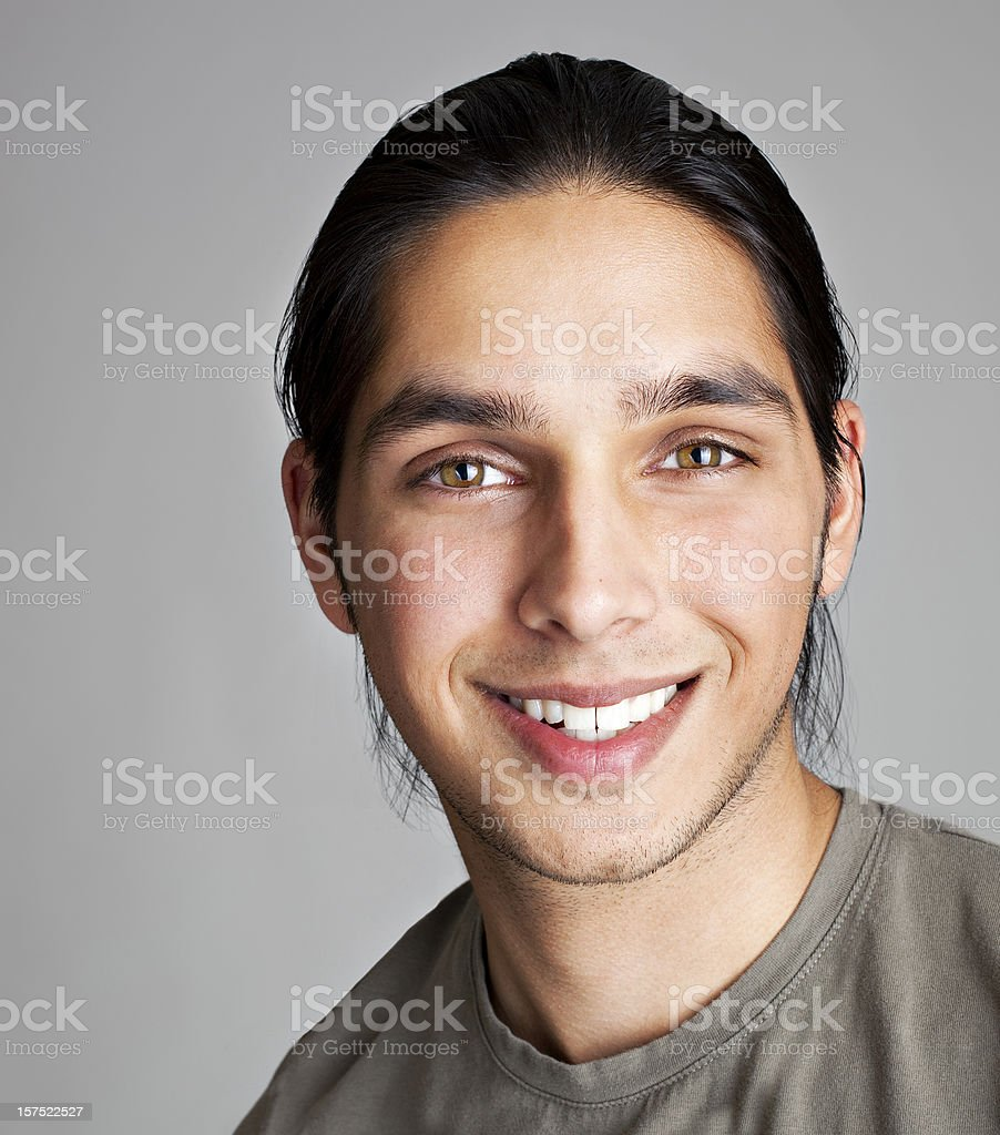 Head shot of a young Indian man smiling royalty-free stock photo