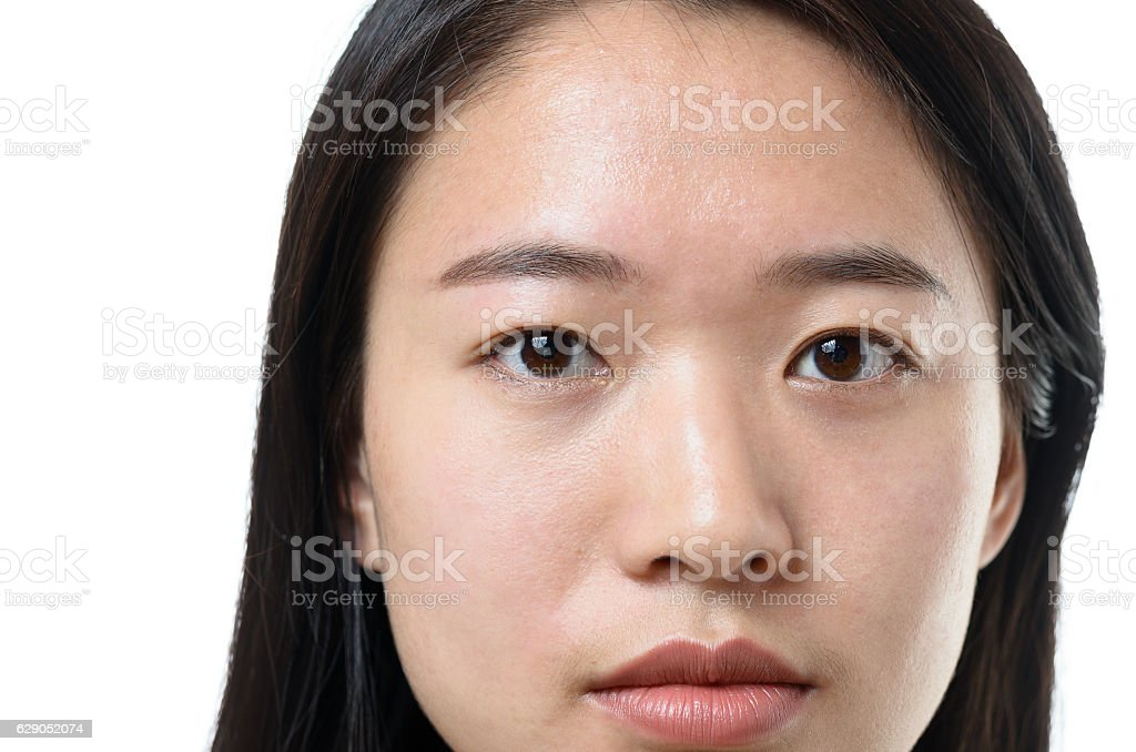 Head shot of an attractive calm Chinese woman stock photo