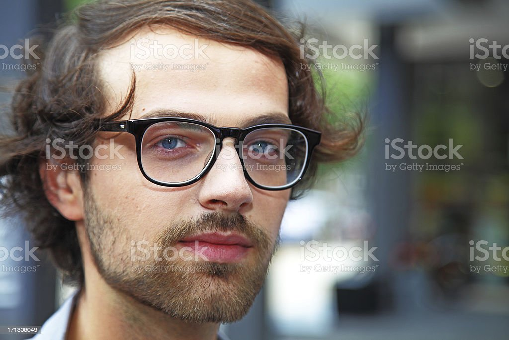 head shot of young man with spectacles stock photo
